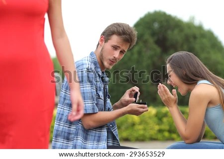 Cheater Man Cheating During Marriage Proposal Stock Photo