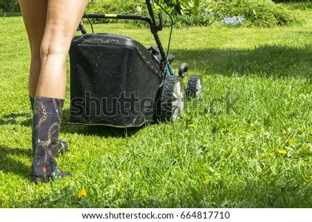 girl lawn mower stock royalty-free