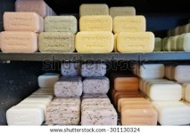 BORMES LES MIMOSAS, FRANCE -25 JULY 2015- La Savonnerie de Bormes is an artisanal provencal perfumery specializing in colorful soaps shaped as pastries such as macaron cookies. - stock photo