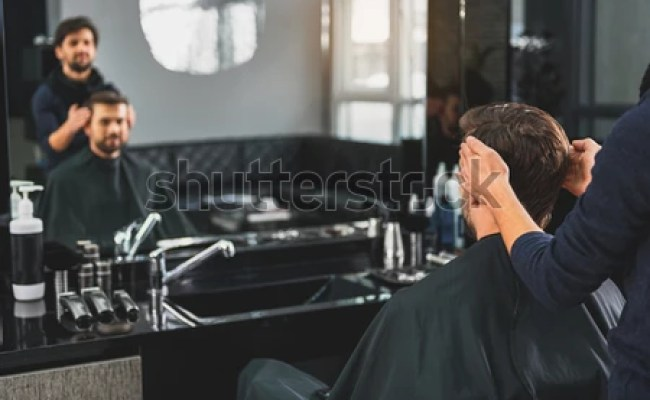 Skillful Hairdresser Cutting Male Hair Stock Photo