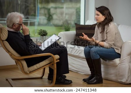 Girl telling about her problems on therapy - stock photo