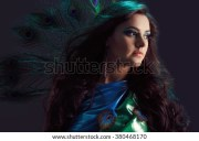 woman brilliant bluegreen dress