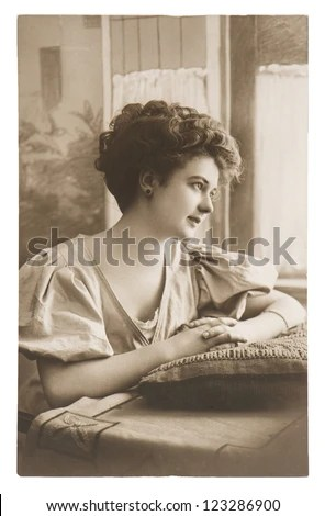 portrait of young sentimental lovely dreamy woman. vintage picture ca. 1910 - stock photo