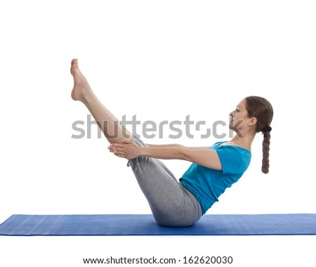 Yoga - young beautiful woman yoga instructor doing Full Boat pose asana (Paripurna navasana) exercise isolated on white background - stock photo