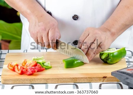 Chef Cutting Bell Pepper Vegetable On Stock Photo