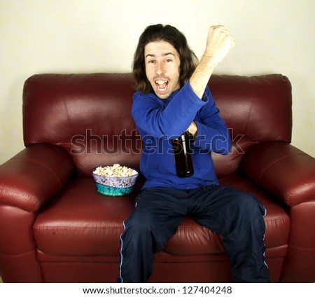 Young Man Look Football On Couch Stock Photo 126412964