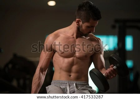 Muscular Bodybuilder Guy Doing Exercises Dumbbells Stock
