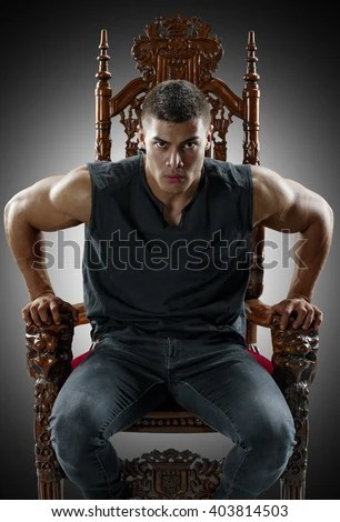 Muscular Young Man Tshirt Jeans Sitting Stock Photo