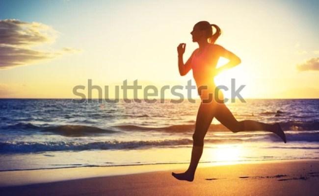 Man Running On Beach Sunset Female Stock Photo 113012746