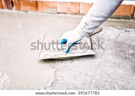 Industrial Worker On Construction Site Laying Stock Photo