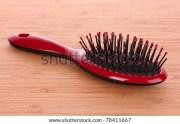 red hair brush stock