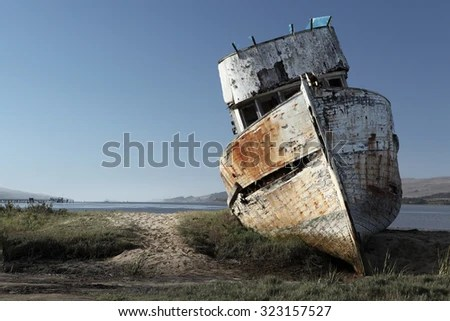 wooden shipwreck stock