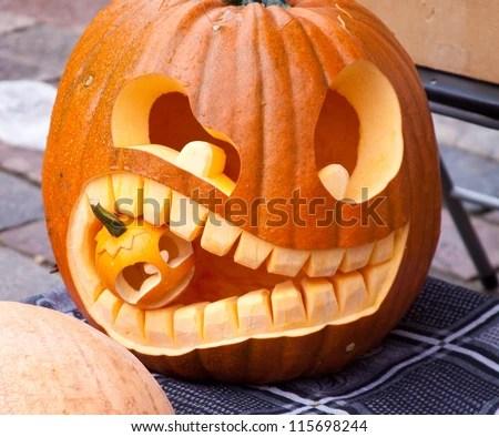 Cuted Halloween Pumpkin Eating Small Pumpkin Stock Photo 115698244 - Shutterstock