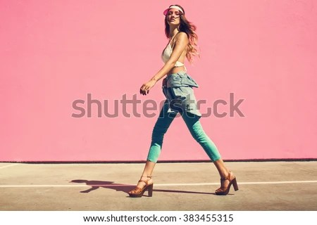 Sexy young woman walking full of confidence. See her body language ? Model daily life movement is like that