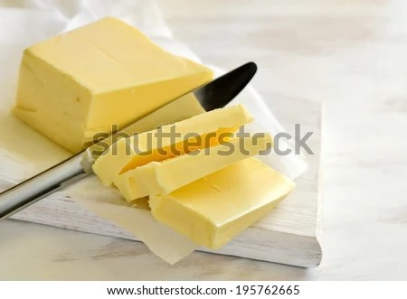 Butter on white board - stock photo