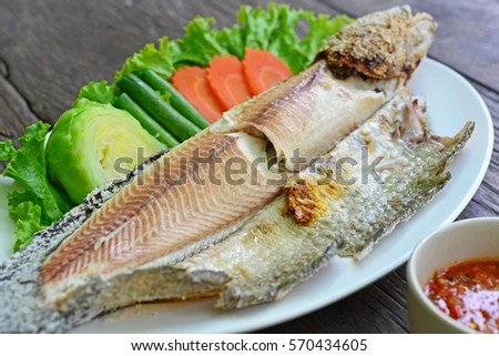 Grilled Fillet Fish On White Plate Stock Photo 609259598