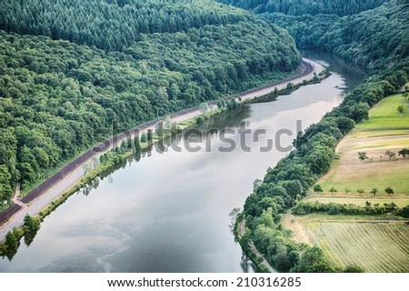 https://i0.wp.com/thumb7.shutterstock.com/display_pic_with_logo/1666885/210316285/stock-photo-the-river-saar-in-germany-passes-along-a-forest-and-farming-fields-210316285.jpg