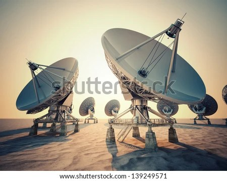 Satellite dish array at sunrise. - stock photo