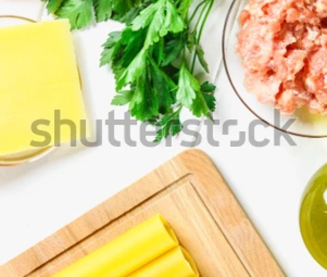 Raw Tube For Stuffing Stuffing Surrounded By Ingredients For Cooking Parmesan