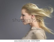 closeup side view of young woman