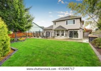 Spacious Backyard Garden Large Beige House Stock Photo ...
