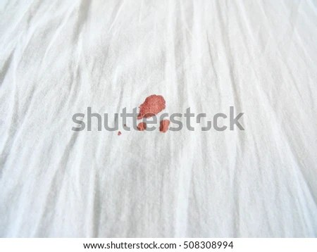 Red Period Spot On White Bed Stock Photo 508308994 ...