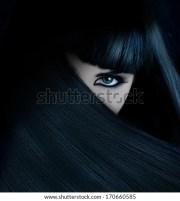 mysterious brunette hair covered