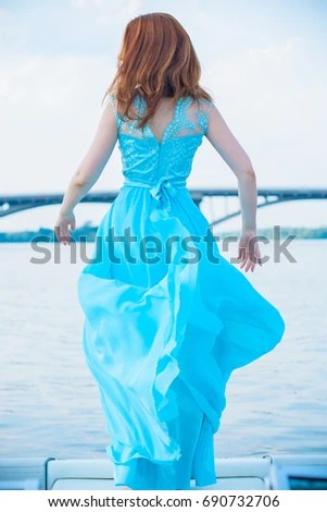 stock photo gorgeous woman in long beautiful flying dress elegant girl in fluttering dress fashion style 690732706 Interacting with Asian Women Through Online dating services