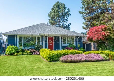 cozy blue house beautiful landscaping