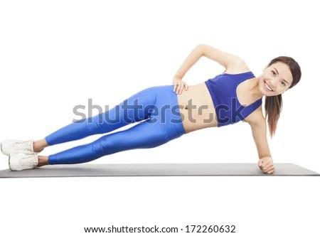 Young beautiful woman doing core workout - stock photo