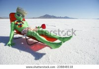 Funny Drunk Green Alien Tourist Goes Stock Photo (Royalty
