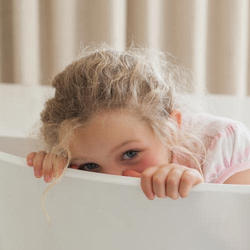 child looking out of a bath