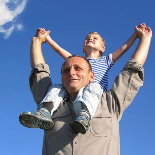 Child on mans shoulders