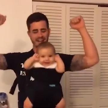baby dances to father