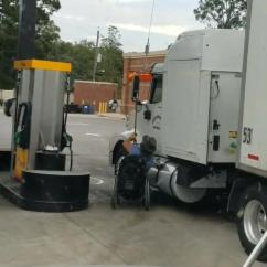 Wheelchair Lift For Truck Beach Mania Chairs Driver In Enters Semi Via Chair Jukin Media Inc Cleans Vehicle At Gas Station