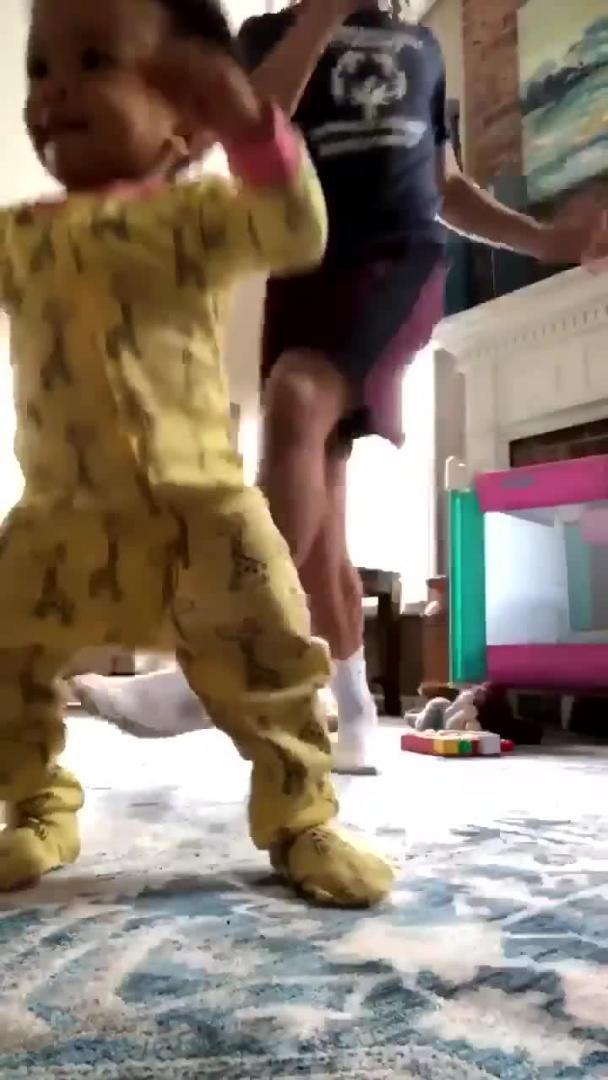 baby dances to turn
