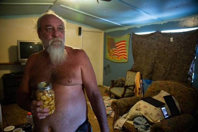 "Franklin Rowe, 55, has lived with mold in his storm-damaged home for nearly a year. ""Ain't got no money to go nowhere else,"" he said."