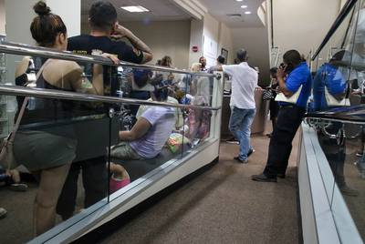 People wait at a driver license reclamation clinic in Austin on June 22, 2018.