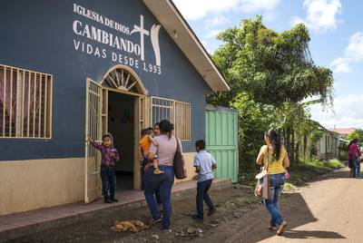 Claudia and her family attend Sunday church in Olancho, Honduras. She says that listening to the Lordís word helps her deal with her current situation. VerÛnica G. C·rdenas for The Texas Tribune