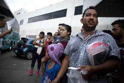 A group of migrants are processed at an immigration checkpoint in Nuevo Laredo. The group requested asylum in the United States, but were promptly returned to Mexico to await their court dates. July 22, 2019.