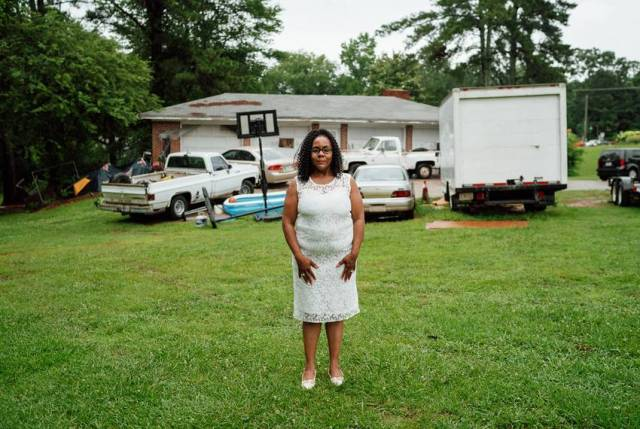 Melissa Alford stands in her yard, where members of a Confederate pride group terrorized a family birthday party she hosted in 2015.
