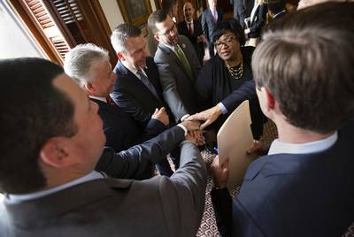 Texas Rep. Toni Rose, D-Dallas, right, chats with other house members on May 7, 2019.