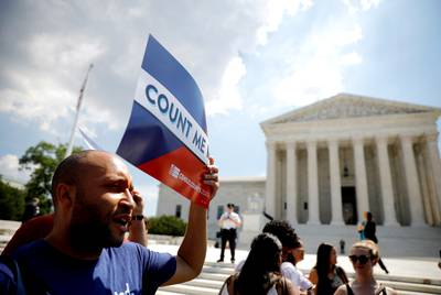 A protester holds a sign outside the U.S. Supreme Court where the court ruled that U.S. President Donald Trump's administration did not give an adequate explanation for its plan to add a citizenship question to the 2020 census, delivering a victory to New York state and others challenging the proposal in Washington, U.S., June 27, 2019. REUTERS/Carlos Barria