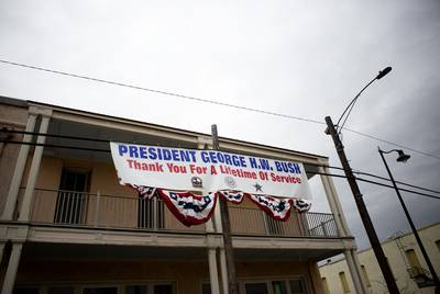A banner thanking former President George H.W. Bush hangs near downtown Navasota. The funeral train carrying the president's remains will pass through town on its way to College Station.