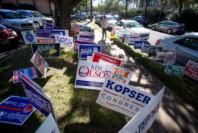 A voter walks into the Howson Branch Library in Austin on the last day of early voting in Travis County.