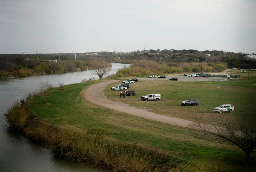 U.S. border patrol cars are seen through the fence of the bridge connecting Eagle Pass, Texas, with Piedras Negras, Mexico, near the banks of Rio Grande, on Feb. 7, 2019.