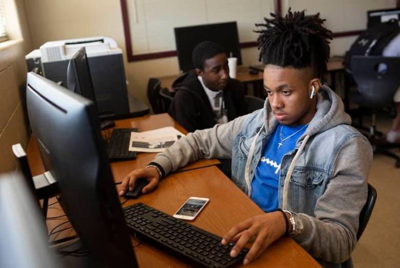 Students at Round Rock High School Addison Savors, left, and Ahmir Johnson, right, at school on April 26, 2019. The expansion of the marshal program could be triggering for black and brown students.