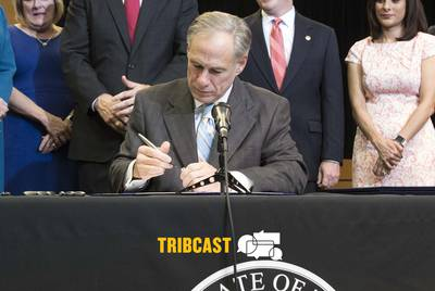 Gov. Greg Abbott signs several bills at a ceremony with state legislators in Austin on May 31, 2017.