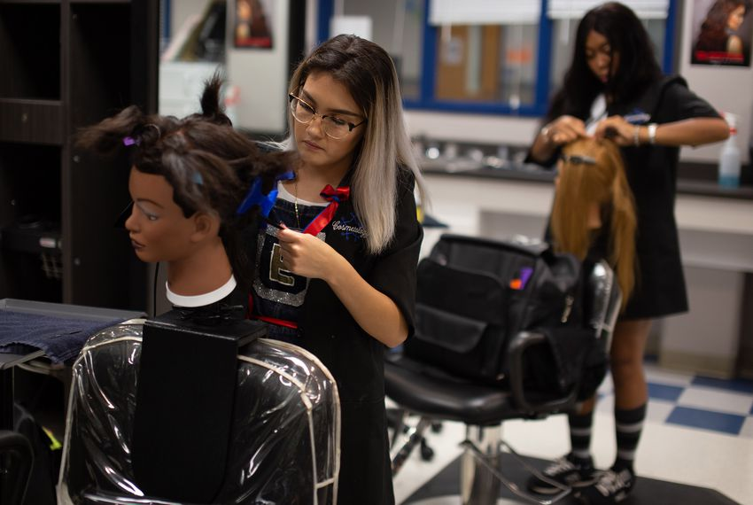 Elizabeth Ruvalcaba and Rahslyn Stallings practice barbering techniques in a cosmetology class at Jack C. Hays High School in Buda on Sept. 7, 2018.
