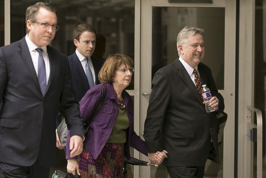 Former U.S. Rep. Steve Stockman, R-Friendswood, right, leaves the United States District Courthouse in Houston on Monday, April 9, 2018, after closing arguments in his federal corruption trial.